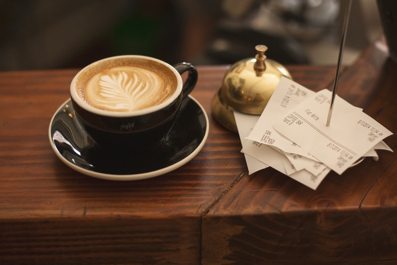 Restaurant receipts and a cup of coffee