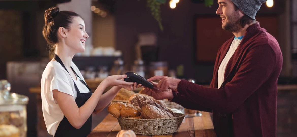 Smiling customer paying with credit card